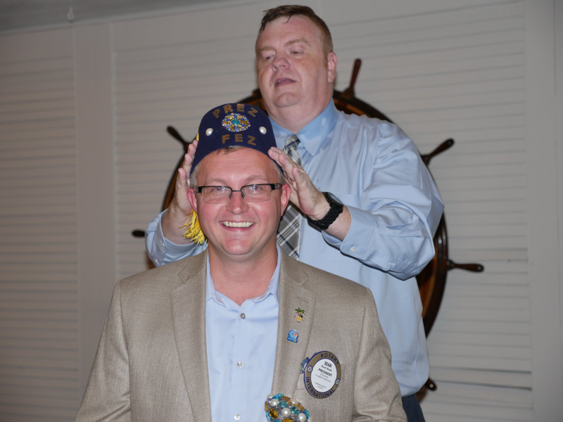 Our new president getting fitted with his crown.
