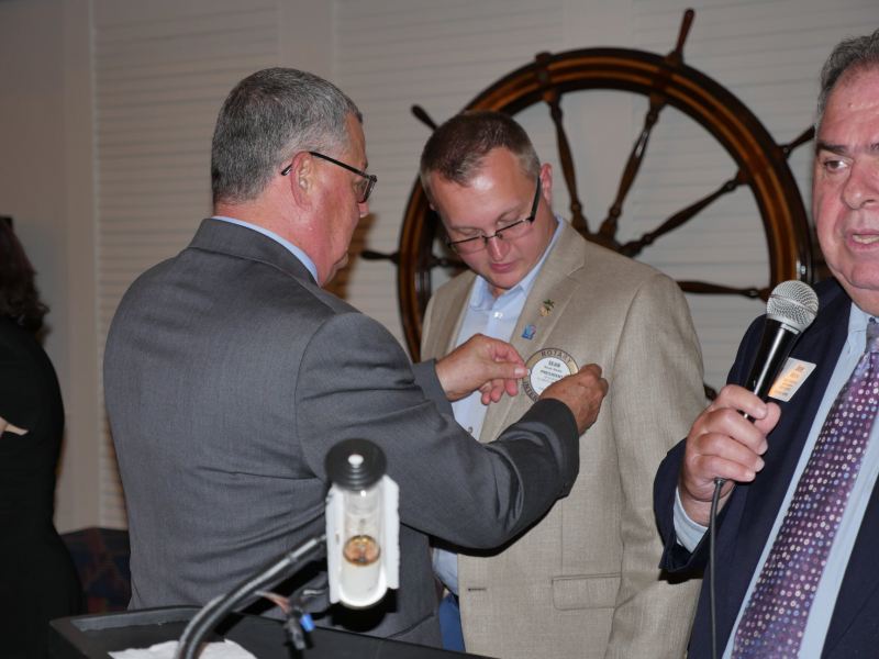 President Sean Hasle getting sworn in by Past District Governor Joe
