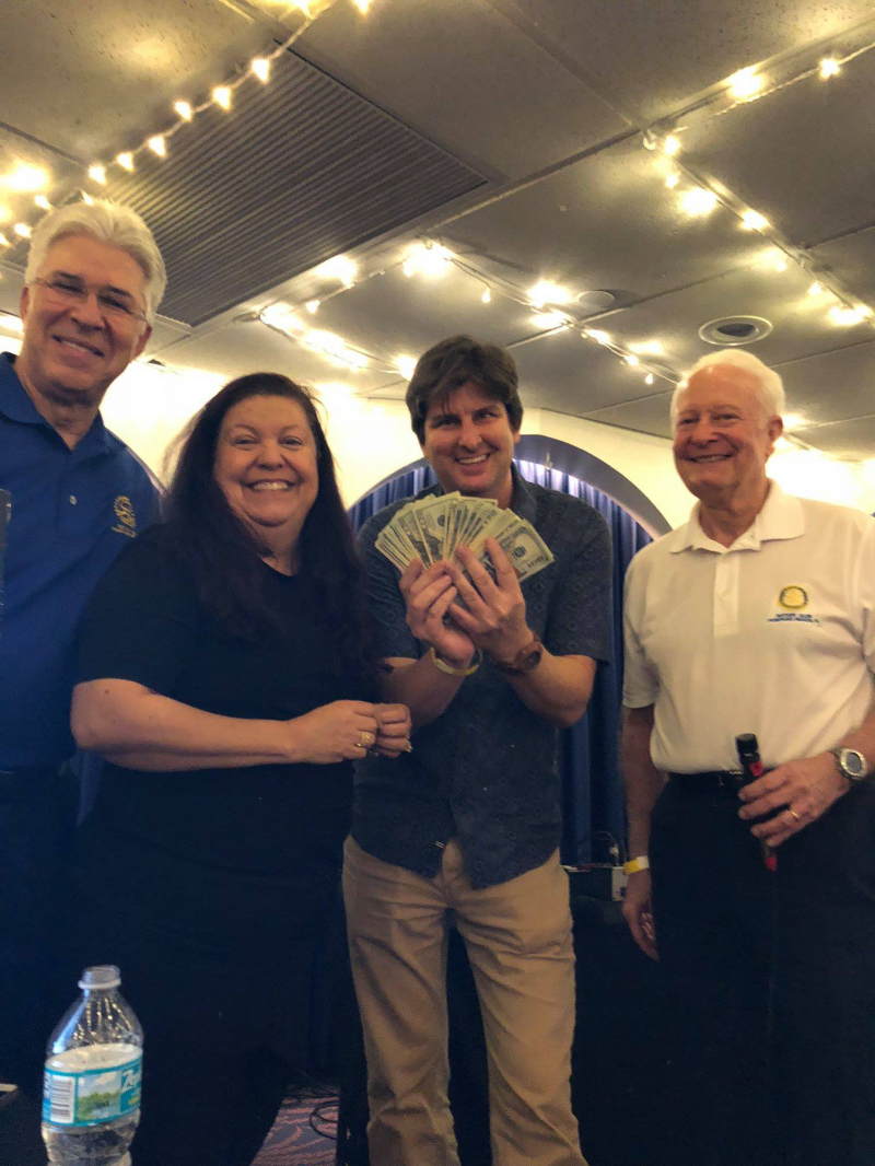 Rotarians Ross Licata, Susan Gingerich, Mike McLain and Dave Doebler (the winner of the 50/50)