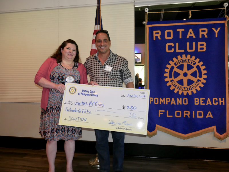 Guitars Not Guns receives a donation from our Rotary Club July 2017
